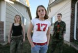(l-r) Kirsten Golgart, 14, Chrissy Post, 12, and Colton Baker, 14, all of Westminster, pose for a...