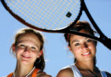 Cherry Creek senior tennis doubles players Christina Macey (right in white, No. 1) and Julie...