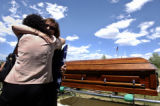 (Colorado Springs, Colo., May 10, 2004) Rita Velasquez, left, aunt of widow Alicia Reed, gives a...