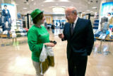 Macy's West Chairman Robert L. Mettler (cq, right) stops to talk with Ginger Davis (cq, left) of...