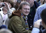 Director Rian Johnson, Buck, makes his way through throngs of fans with cameras on Saturday...