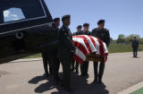 (Colorado Springs, Colo., May 10, 2004) A military honor guard carries the casket of PFC Ryan Reed...