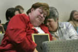 After her testmony, Julie MacKenzie (cq) weeps as she holds a picture of her son Tyler Ryan...