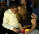 (Colorado Springs, Colo., May 10, 2004) Michael Garcia, 17, comforts his sister Alicia Reed at the...