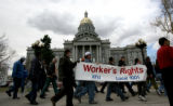 Union members march past the state Capitol, Thursday Apr. 6, 2006 after they rallied in response...