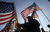 (CENTER) Ken Grimes (CQ), Lakewood, member of the Patriot Guard Riders turned out in support of...