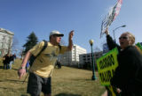 Timothy Coon (cq), of Denver, left, yells at Margie Phelps (cq), right, daughter of Fred Phelps,...