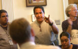 Protester Ernesto Vigil, 56, addresses Denver Mayor John Hickenlooper's chief of staff Michael...