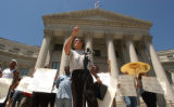 [(Denver, colo., Shot on: 7/12/04)] Protester Ernesto Vigil, 56, addresses the media in front of...