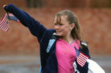 Kayla Pratt, (cq) 12, waves the American flag during a  morning rally outside of Shaw Elementary...