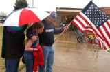 Dane Swanson (cq) hugs his daughter Braina (cq) age 11, during a  morning rally outside of Shaw...