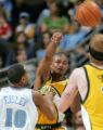 Former Denver Nugget guard Earl Watson, right, is guarded by Denver Nugget guard Howard Eisley,...