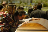 (Colorado Springs, Colo., May 10, 2004) Leonarde Brown, father of PFC Ryan Reed, hugs the casket...