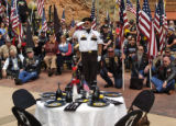 Warren Tellgren (cq), center, member of the National Honor Guard, salutes and calls out during a...