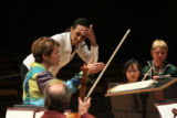 (LT. TO RT.) Colorado Symphony Orchestra Conductor Laureate Marin Alsop (CQ), coaches guest...