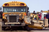 AP Photo/Bradley Wakoff/Greeley Tribune A school bus with its hood ripped off sits askew on U.S....
