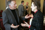 Congressman Tom Tancredo (cq) speaks to Ruth Silver (cq) after his lecture on immigration to...
