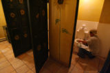 Mexican immigrant Enrique Hernandez, 42, cleans restrooms at a restaurant in Telluride, before...