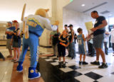 Young Nuggets fan Zack Yanda (cq, center), 5, of Littleton high-fives Rocky as he and his older...