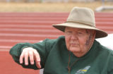 (LT. TO RT.) Mullen High School Track and Field Coach John Hoskins (CQ), 77, coaches after school...