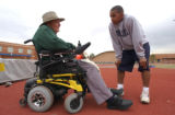 (LT. TO RT.) Mullen High School Track and Field Coach John Hoskins (CQ), 77, coaches Track and...