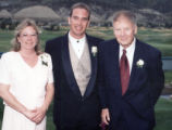 Susan, Stan and John Hoskins smile for the camera on the occasion of Stan's wedding. (1995 or...