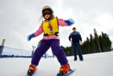 Five year old Rebecca Olson (cq) of Colorado Springs does her best to stay upright as her father...
