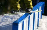 A snowboarder board slides a rail at Echo Mountain Park near Evergreen on Sunday April 9, 2006....