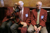 Tuskegee airmen, Col. John Smith, (cq) and Samuel Hunter, (cq) (l-r) laugh as they look at some...