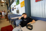 Cameron Lawrence (cq) of Denver chills out between runs in the lodge at Echo Mountain Park near...