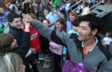 Toby Dawson (cq), high-fives a bunch of fans after he was honored by the city of Vail with a...