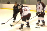 Rob Blake, (cq), takes on Larry Sloan, (cq), 13, (#50) Centennial, stick on the ice, the...