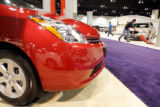 Jeff Maes, cq, Denver, vacuums in preparation for the official opening of the Denver Auto Show at...