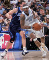 Denver Nuggets forward Carmelo Anthiny, right, drives past the Utah Jazz's Matt Harpring, left,...