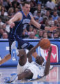 Denver Nuggets forward Reggie Evans falls on his back as he looks to pass the ball with Utah Jazz...