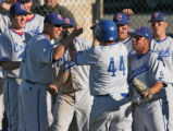 Cherry Creek Jack Burk (44) celebrates with team members after hitting a home run in the top the...