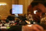 (Reflected in Window) Lobbyist lobby Colorado State Representatives outside the House floor, while...