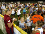 USA Olympic softball pitcher Jenny Finch signs autographs following a pair of exhibition games in...
