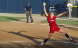 USA Olympic softball pitcher Jenny Finch casts a long shadow as she pitches in an exhibition game...