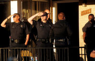 Denver Police and investigators wait for a search warrent on the steps of the Denver home of DeDe...