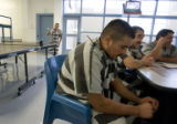 Illegal immigrant Missael Alvarado, 23, shows his frustration while waiting to be deported by ICE...