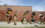 Members of Grupo Tlaloc, an Aztec dance group, march through the campus at the 2nd Annual Latino...