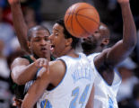 Minnesota Timberwolves' guard Rashad McCants, left, passes the ball in the first quarter of play...