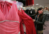 Prom Fashion on March 30, 2006 at FlatIron Crossing.  Stylist Tobie Orr (cq) picks out prom...