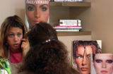 (BOULDER, Colo., July 13, 2004) Jaime Losey, make up artist, asks questions of the subject with...
