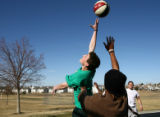 Michael Stillwagon, left, and Josh Madry play basketball at a gathering during a...