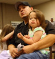 Amalgamated Transit Union Local 1001 member Chris Moralez sits with two of his daughters Maci, 3,...