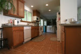 New tile flooring and amoreopen floor plan have made Tingey family life easier at their remodeled...