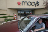 DLM02121   Jim Stanley waits for his wife Betty outside the Macy's department store in Boulder,...