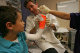 Richard G. May, MD, right,  a Colorado Orthopedic Surgery Specialist prepairs a cast for Andreas...